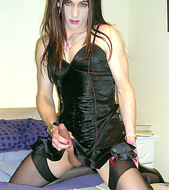 Sexy crossdresser Kirsty wearing a tight black dress and showing her cock